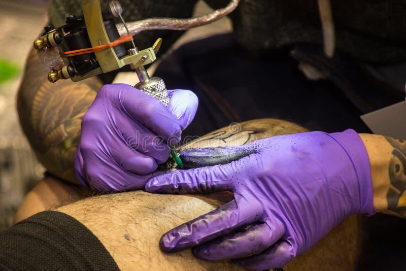 Download Professional Tattoo Artist Makes A Tattoo Editorial Photo - Image: 83710166