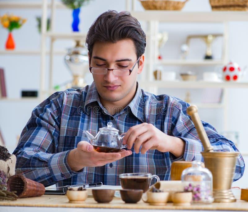 Professional tea expert trying new brews. The professional tea expert trying new brews royalty free stock photos
