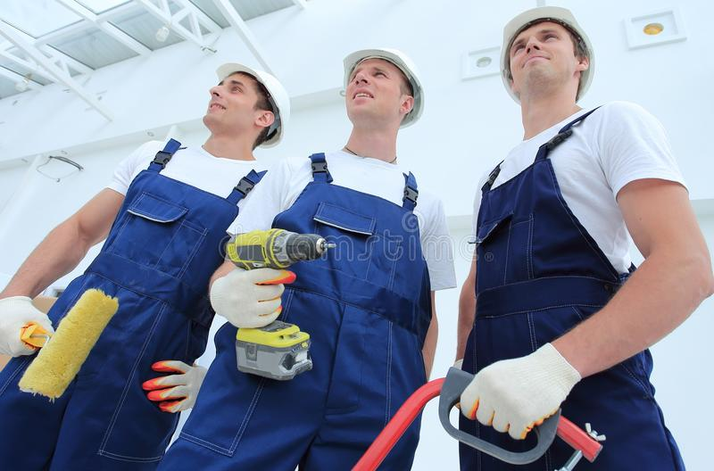 Professional team of builders with tools stock images