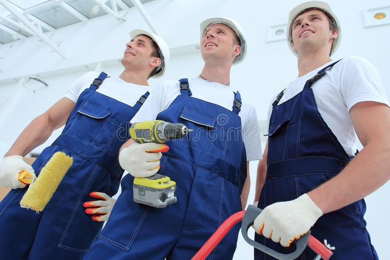 Professional team of builders with tools royalty free stock image