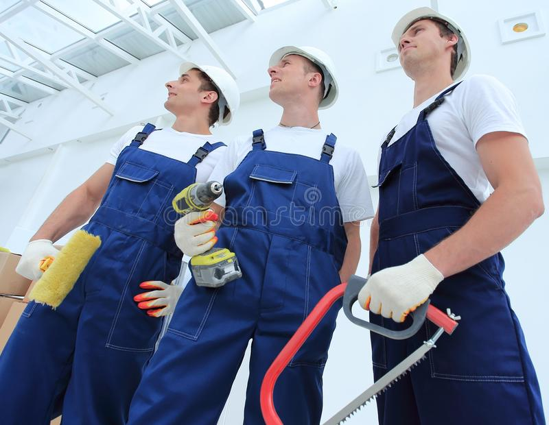 Professional team of builders with tools royalty free stock photos