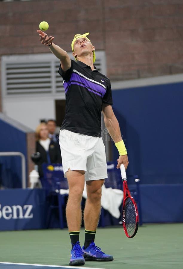 Professional tennis player Denis Shapolvalov of Canada in action during his 2019 US Open first round match στοκ εικόνα με δικαίωμα ελεύθερης χρήσης
