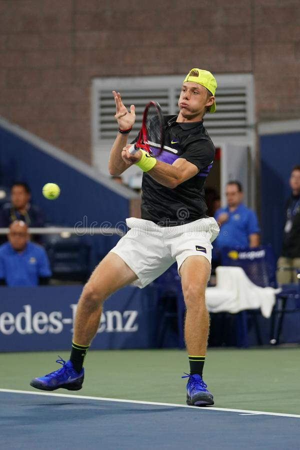 Professional tennis player Denis Shapolvalov of Canada in action during his 2019 US Open first round match στοκ εικόνες