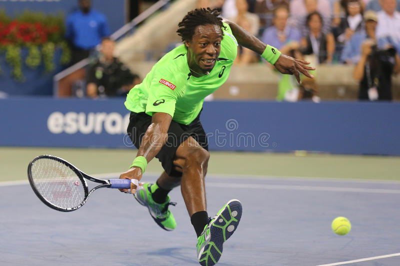 Professional tennis player Gael Monfis during quarterfinal match against seventeen times Grand Slam champion Roger Federer stock images
