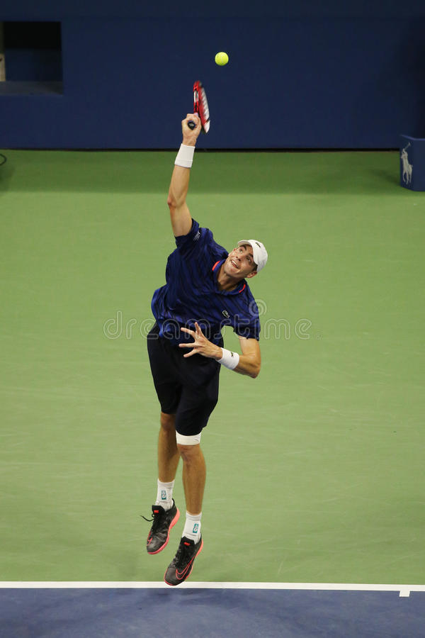 Professional tennis player John Isner of United States in action during his fourth round match at US Open 2015. NEW YORK - SEPTEMBER 7, 2015: Professional tennis royalty free stock image