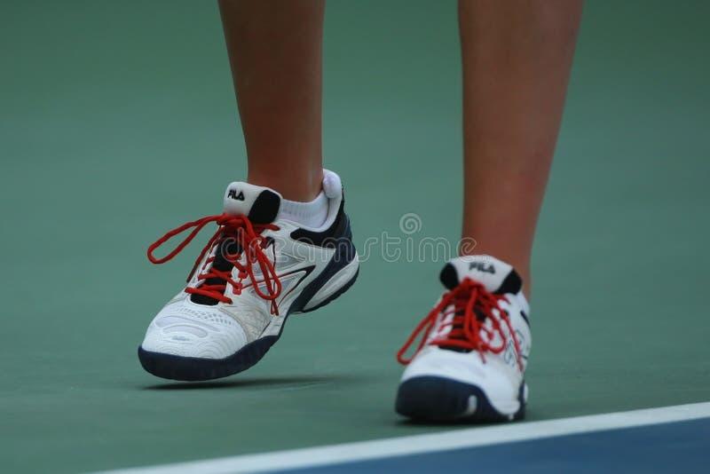 Professional tennis player Karolina Pliskova of Czech Republic wears Fila tennis shoes during her match at US Open 2016. NEW YORK - SEPTEMBER 5, 2016 royalty free stock photos