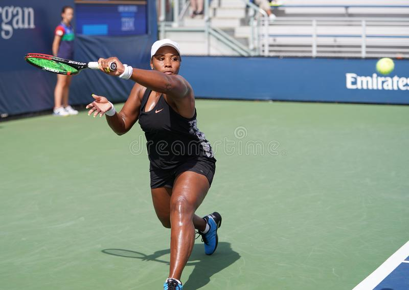 Professional tennis player Taylor Townsend of United States in action during her 2019 US Open first round match. NEW YORK - AUGUST 27, 2019: Professional tennis stock photo