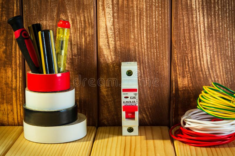 Professional tool for electrician on vintage wooden background royalty free stock photos