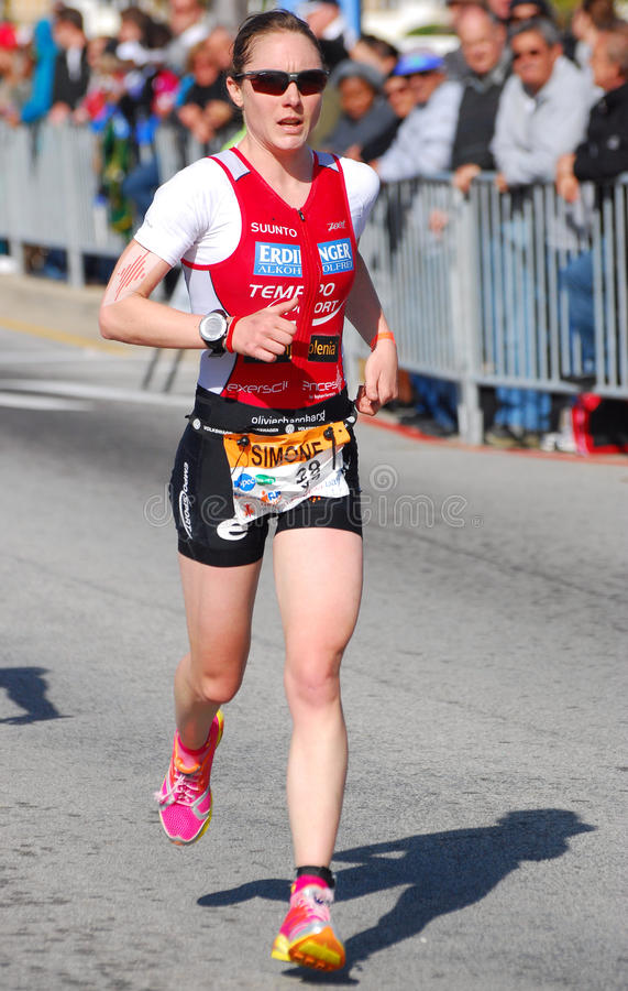 Professional triathlete running royalty free stock image