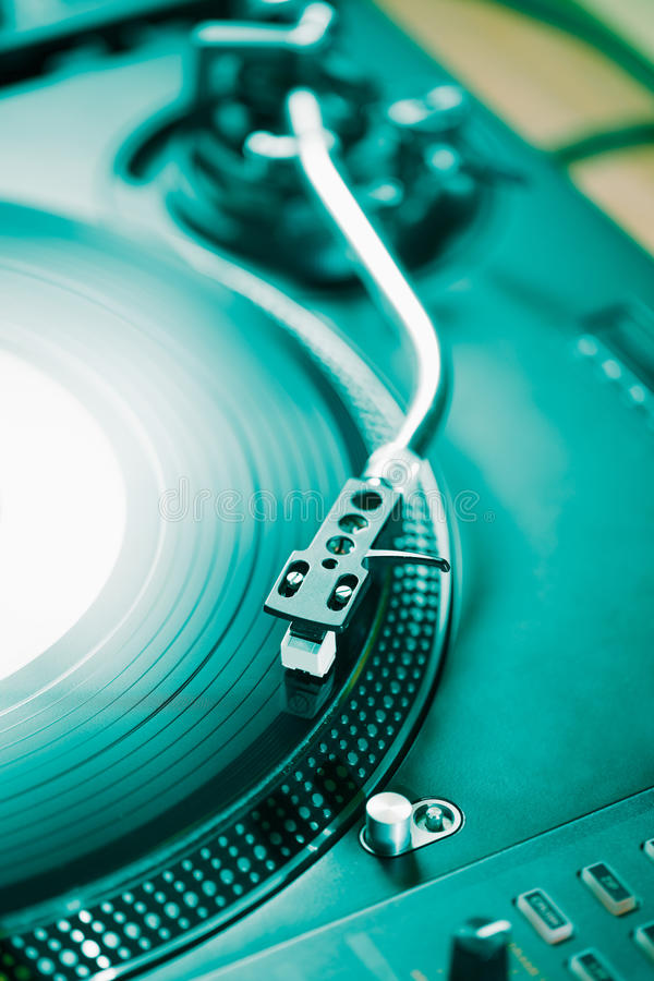 Professional turntable audio vinyl record music player. Turntable vinyl record player, analog sound technology for DJ playing analog and digital music. Close up royalty free stock photo
