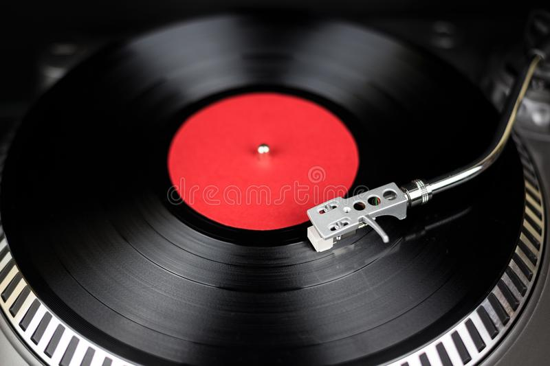 Professional turntable close-up. Analog stage audio equipment for concert in nightclub. Play mix music tracks on vinyl. Professional party djs turn table.Analog royalty free stock images