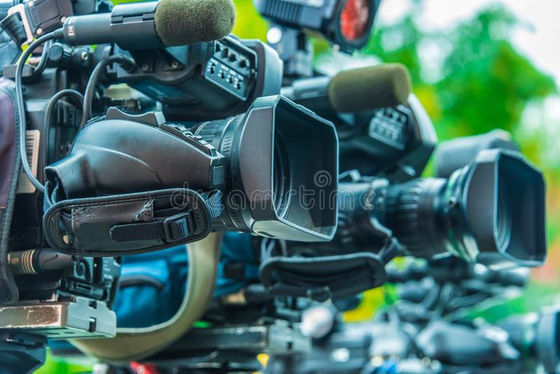 Professional tv cameras on tripods recording social event royalty free stock photography