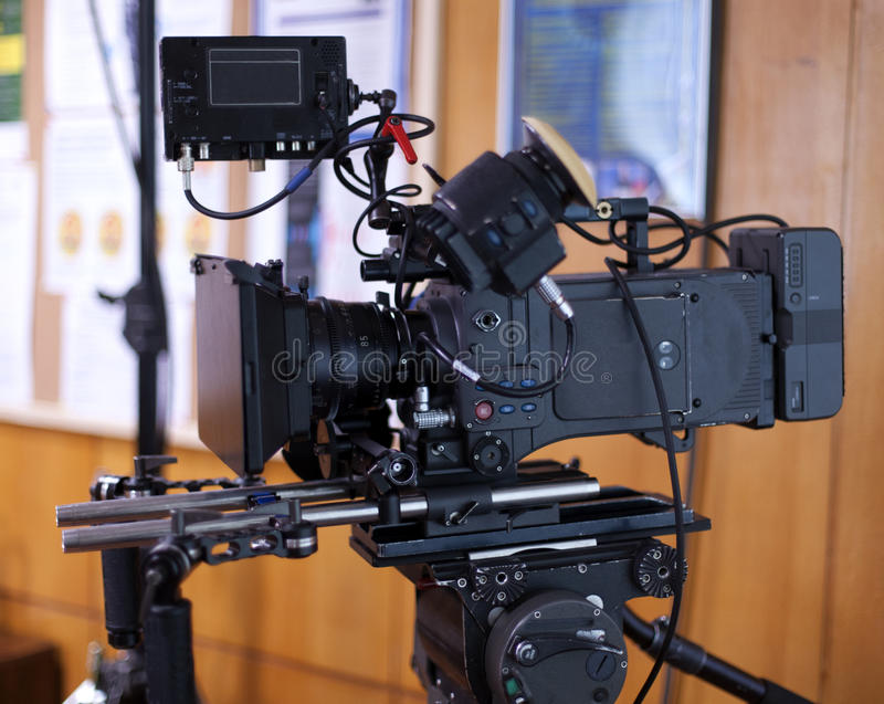 A professional video camera. Camera for shooting feature films and television series royalty free stock images
