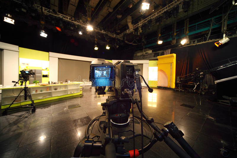 Professional video camera in television studio royalty free stock photo