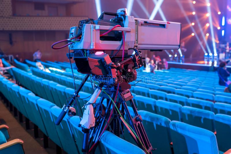 Professional video camera on a tripod with a screen for events and TV broadcasting royalty free stock image