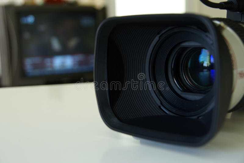 Professional video camera with a TV monitor royalty free stock image