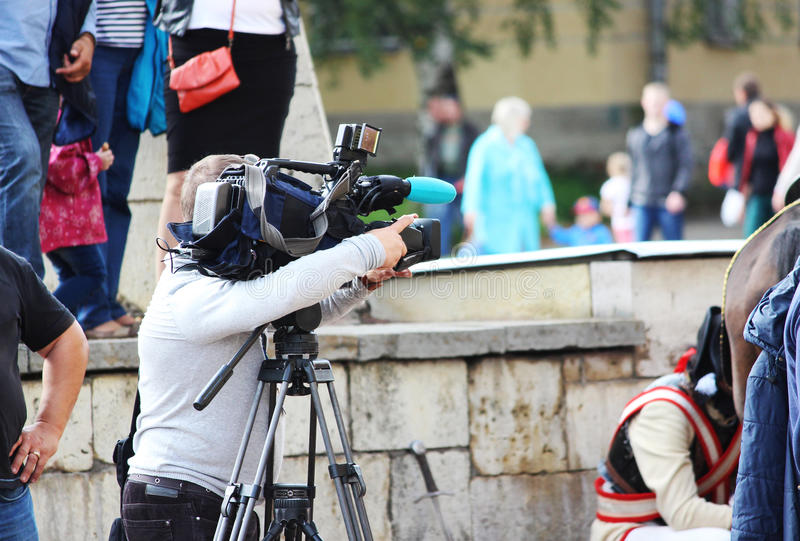 professional videographer shoots on video camera a City Day in Gatchina, Leningrad Region Russia. stock photography