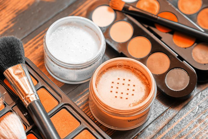 Matte loose powder. Professional visagiste workspace. Makeup tools. Creative mess stock photo
