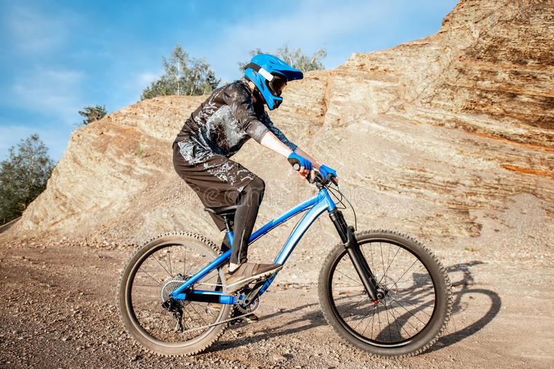 Cyclist riding on the rocky mountains stock images