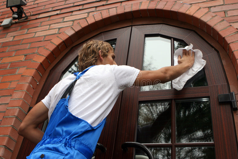 Professional window cleaner royalty free stock photos