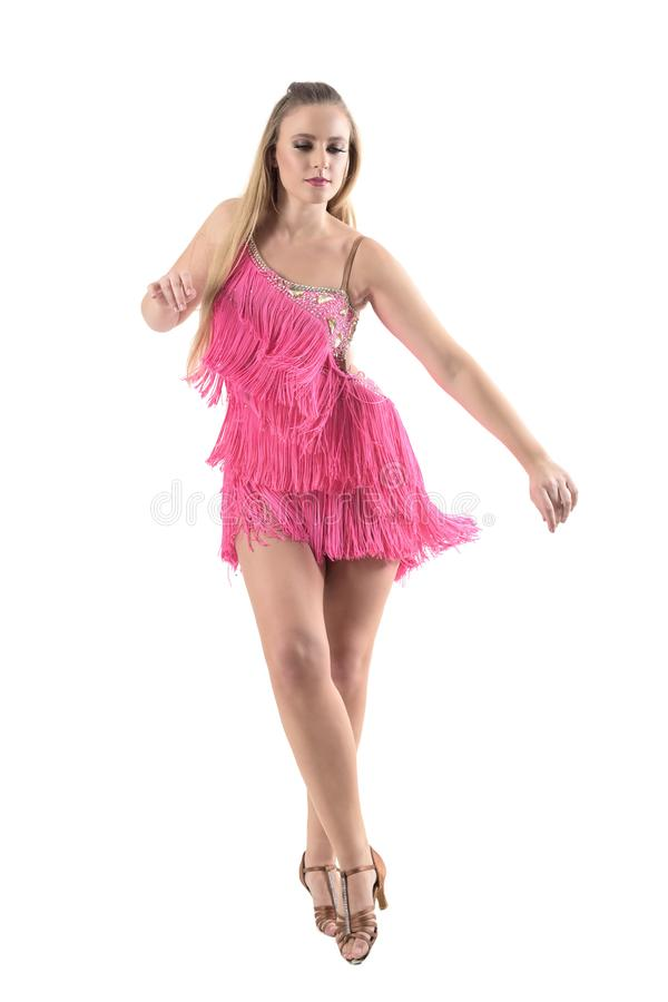 Professional woman dancing latino dances looking down. Front view royalty free stock images