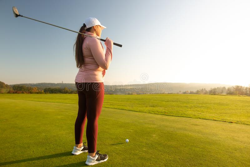 Professional woman golf player ready for competition on the golf. Sport concept stock photos