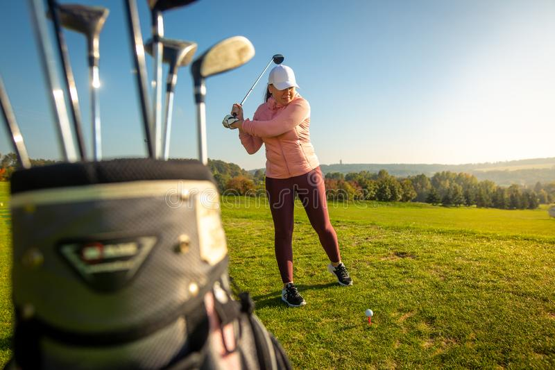 Professional woman golf player ready for competition on the golf. Sport concept stock images