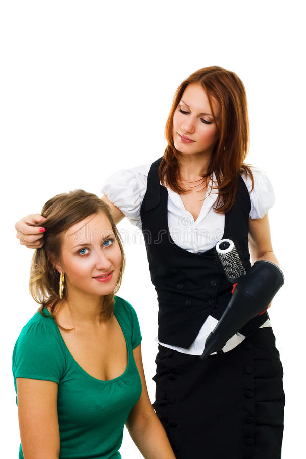Professional woman hairdresser at work. Professional woman hairdresser make hair setting for client stock photo
