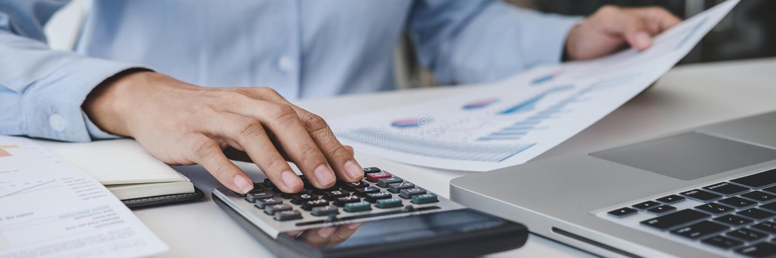 Professional at work, business woman working and analyzing on laptop with calculate statistics of financial document data graph royalty free stock photo