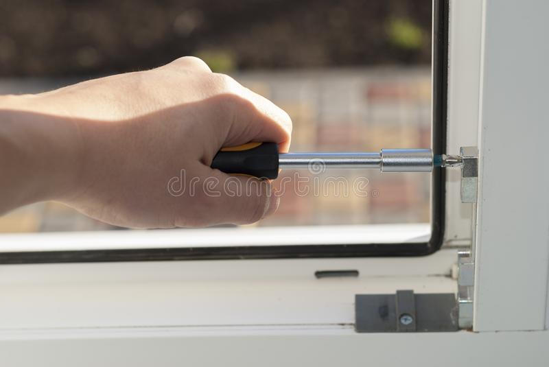Repair of plastic windows stock photography