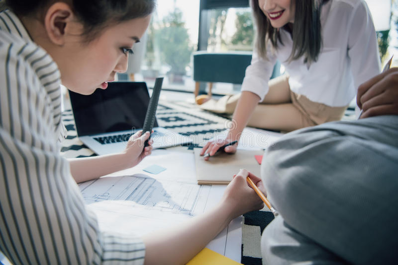 Professional young architects working with blueprint in office royalty free stock photos