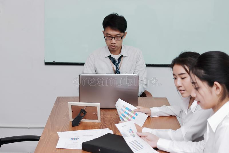 Professional young Asian business people meeting in conference room of office stock image