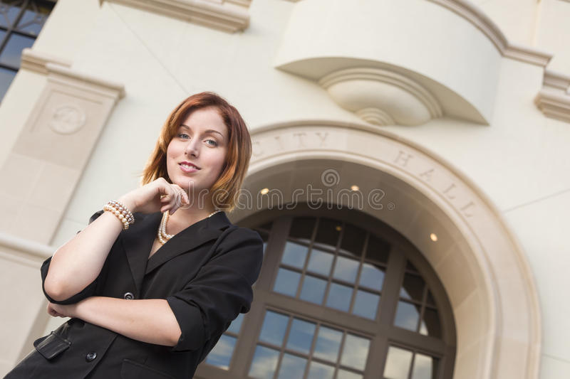 Professional Young Businesswoman Outside in Front of City Hall royalty free stock photography