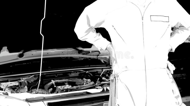 Download Professional Young Mechanic Man Against Car In Open Hood At The  Repair Garage In Black
