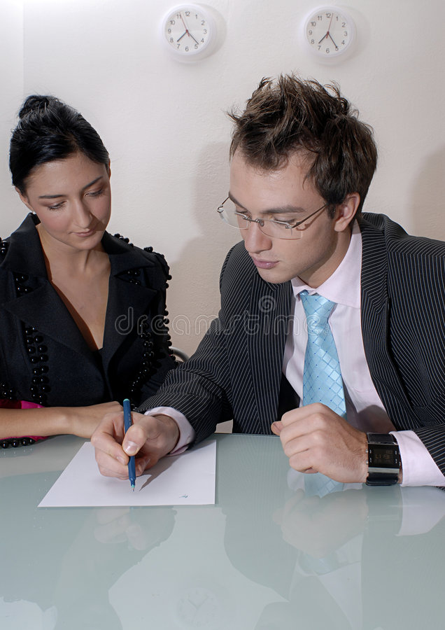 Professionals analyzing notes royalty free stock photography