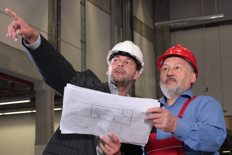 professionals with blueprints royalty free stock photos