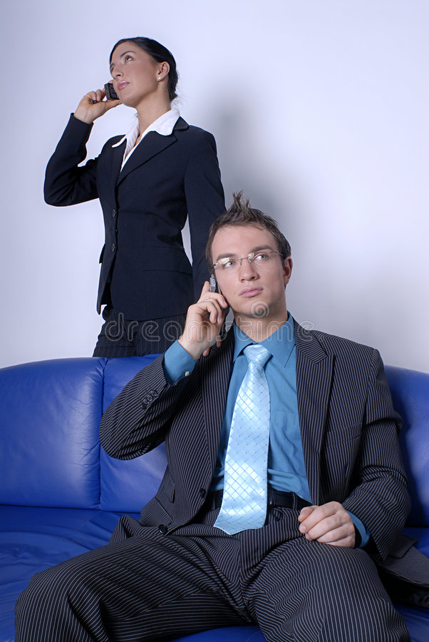 Professionals on cell phones royalty free stock photos