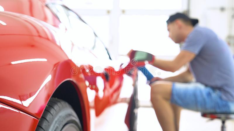 Professionals wear Chemical protective clothing at work.Car Care Business. Automobile industry. Car wash and coating business with royalty free stock photos