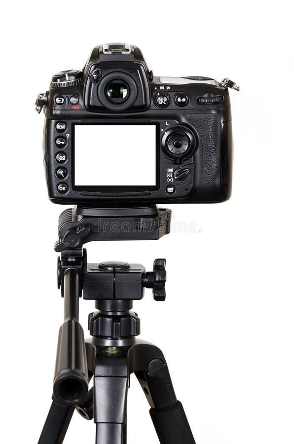 Professionele digitale camera met het lege die scherm op een driepoot op witte achtergrond wordt geïsoleerd royalty-vrije stock foto's