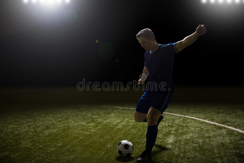 Professionele voetballer in actie royalty-vrije stock foto