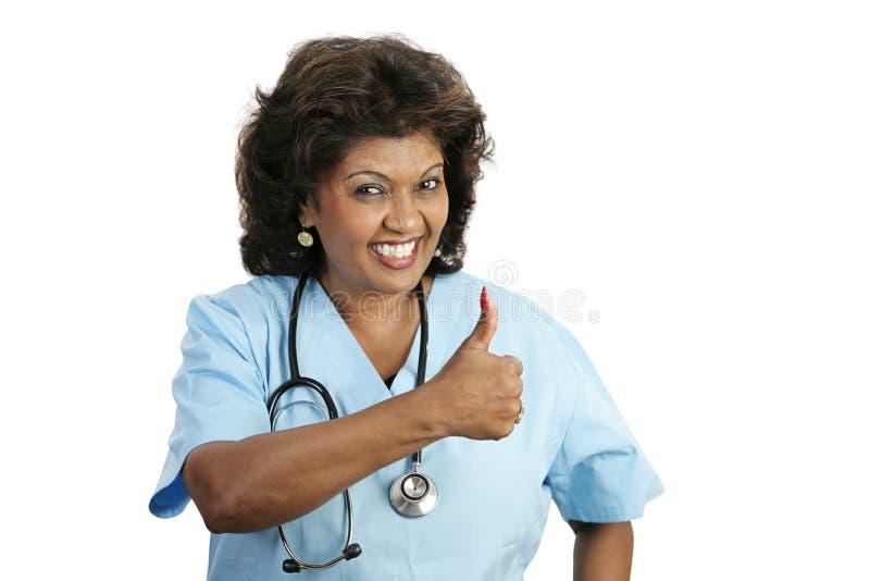 Professionista medico - pollici in su immagine stock