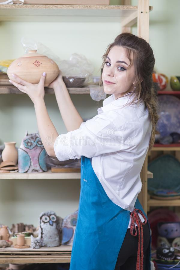 Professions Ideas and Concepts. Young Happy Caucasian Female Potter stock images