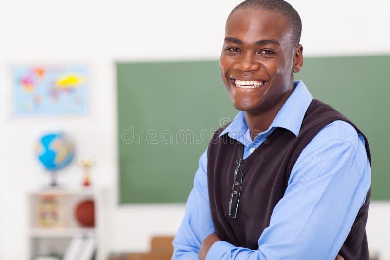 Professor africano feliz imagem de stock