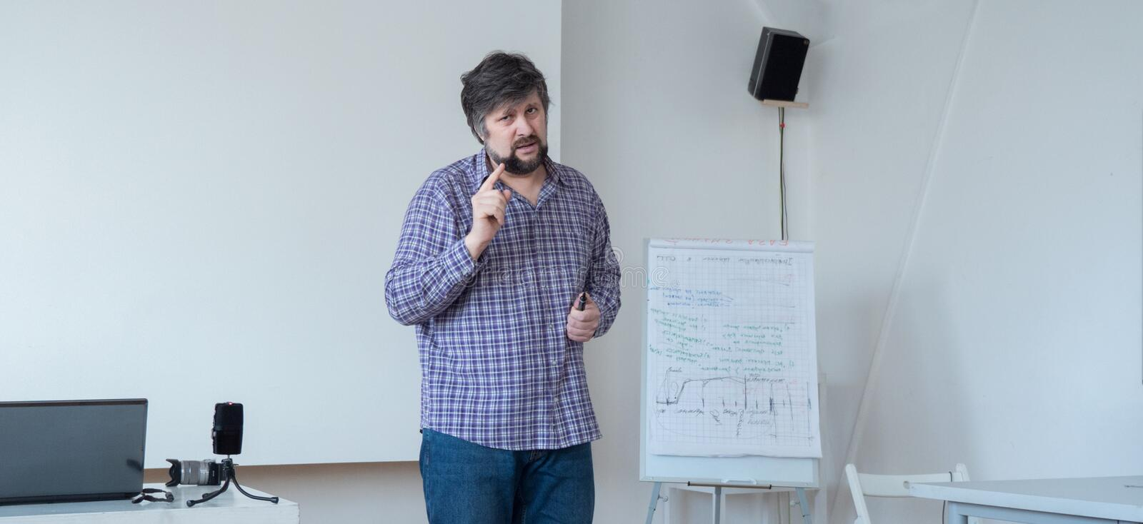 Professor with beard and mustache Screensaver web page. Male, teacher warning. Teacher in casual clothing teaching stock photos
