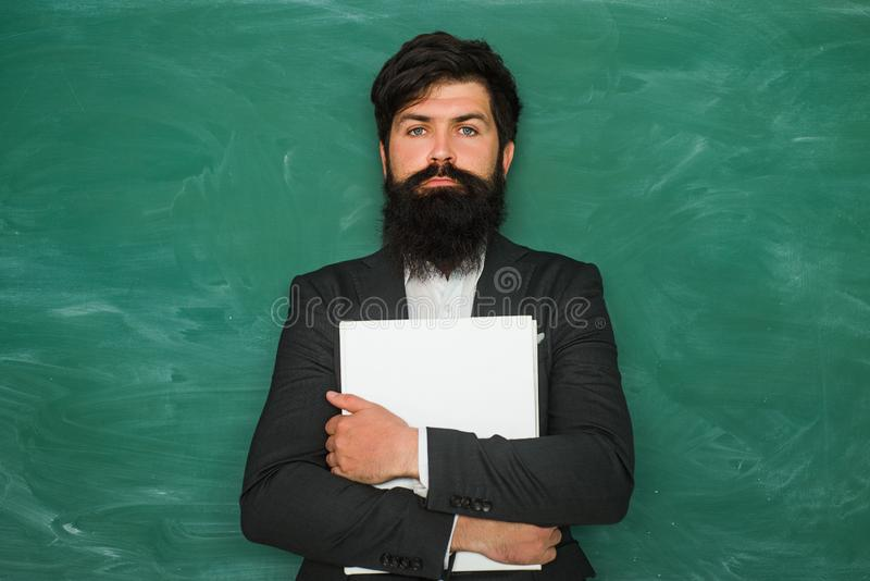 Professor in class on blackboard background. Academic success is much more about hard work than inborn talent. Knowledge royalty free stock photo