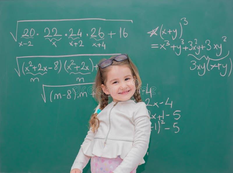 Professor da menina da criança foto de stock