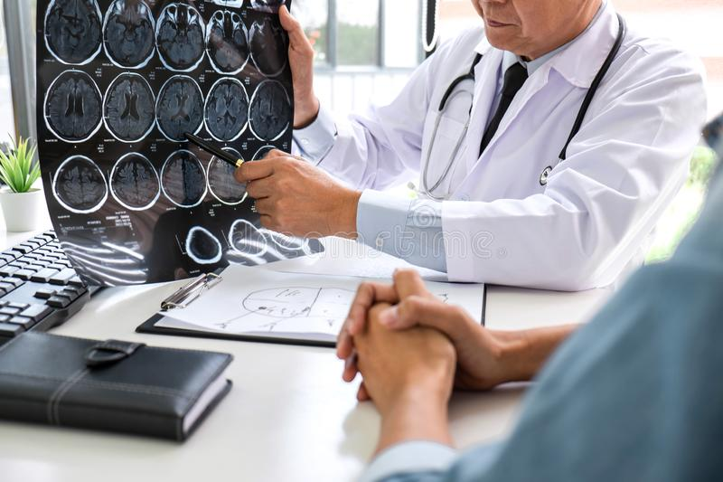 Professor Doctor having conversation with patient and holding x-ray film while discussing explaining her symptoms or counsel stock photos