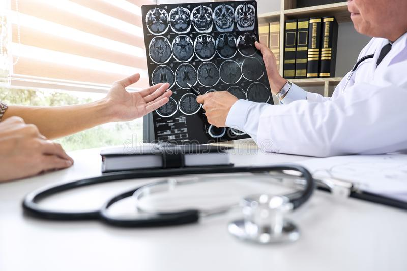 Professor Doctor having conversation with patient and holding x-ray film while discussing explaining symptoms or counsel diagnosis stock photos