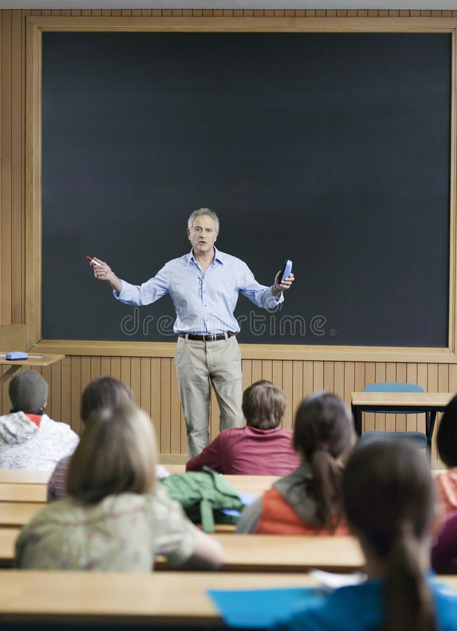 Professor giving a lecture stock image