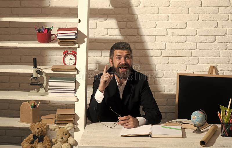 Professor with happy face having idea. Teacher and school supplies royalty free stock photos